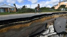Natural disasters dampen Swiss Re profits