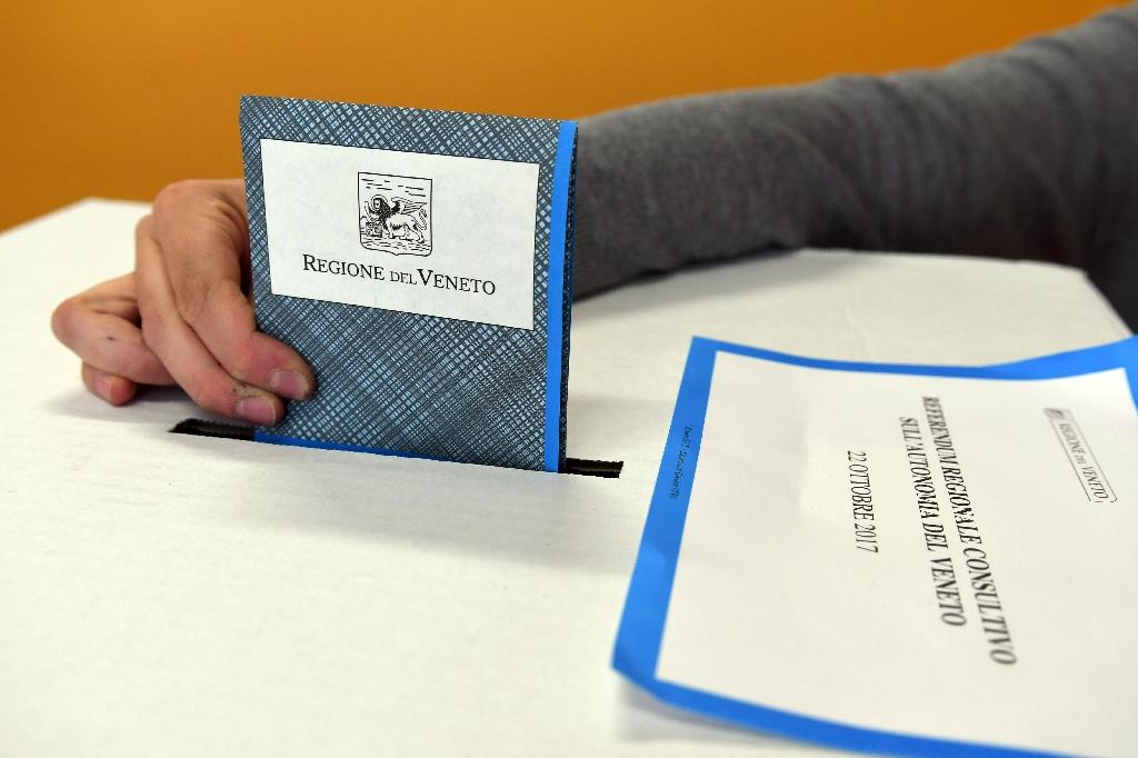 Voters in Lombardy and Veneto are being asked to vote Yes or No for greater autonomy (AFP Photo/ANDREA PATTARO)