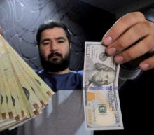 In first move since FX crackdown, Iran lowers rial vs dollar