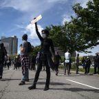 Tension escalates into violence in fiery Atlanta rally, around nation