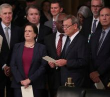 Reluctant U.S. Supreme Court on collision course with Trump