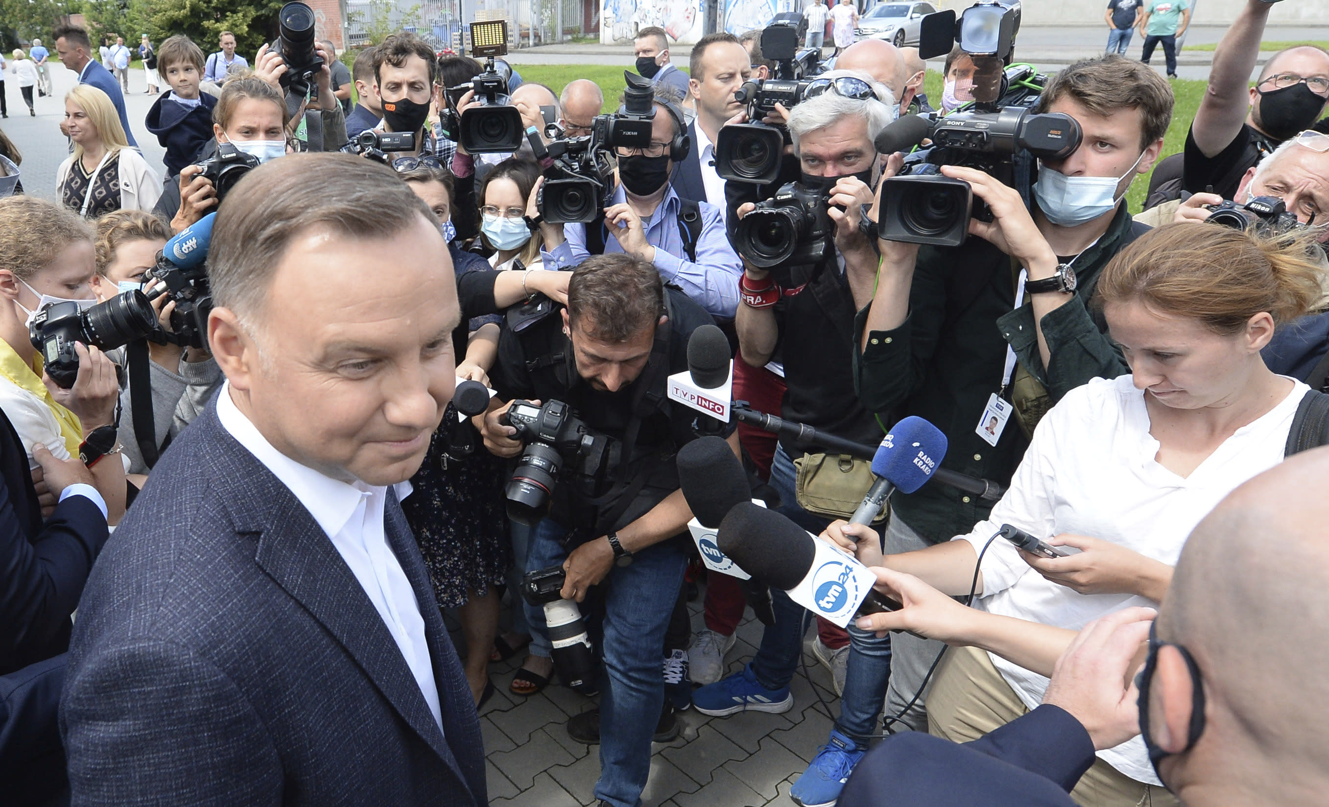 Candidate in Poland's tight presidential election runoff, incumbent President Andrzej Duda talks to reporters after having cast his ballot at a polling station in his hometown of Krakow, Poland, on Sunday, July 12, 2020. Conservative Duda is running against liberal Warsaw Mayor Rafal Trzaskowski and latest opinion polls suggest the race will be decided by a very narrow margin.(AP Photo/Czarek Sokolowski)