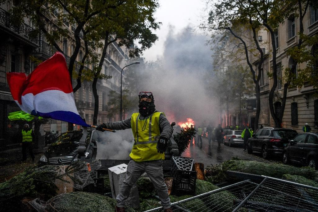 """So far four people have died and hundreds have been injured during the """"yellow vest"""" movement in France, that led to the worst Paris riots in decades (AFP Photo/Alain JOCARD)"""