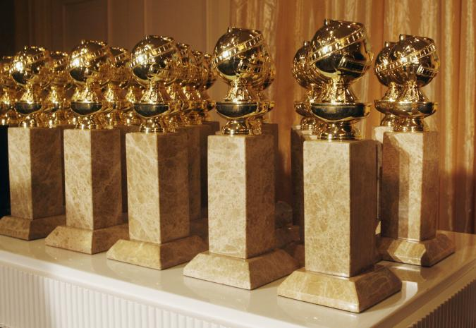 The Hollywood Foreign Press Association's new Golden Globe statuettes are shown during a news conference in Beverly Hills, California January 6, 2009. The new statuette features a facelift to the metal top and a new marble type. The Golden Globe Awards will be held January 11 in Beverly Hills. REUTERS/Fred Prouser (UNITED STATES)