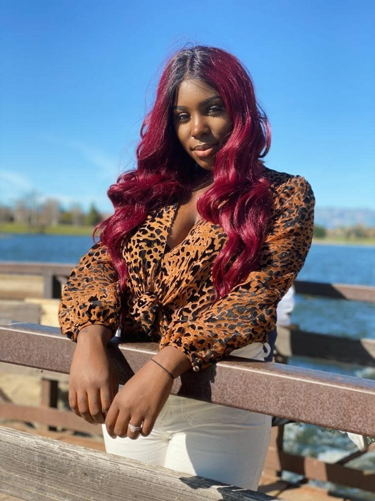 """Sarah Palafox, an African American woman who sings regional Mexican music, poses in Moreno Valley, Calif., in this undated photo. Palafox, who goes by the name Sarah La Morena, was born in Southern California but raised in the Mexican state of Zacatecas. The 23-year-old has sparked many emotions following a series of viral video performances on social media. (Edward """"E-Dub"""" Rios/Silent Giant Entertainment via AP)"""
