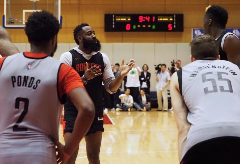 Houston Rockets star James Harden (2nd L) apologised to China over a tweet by the team's general manager backing Hong Kong's pro-democracy protests (AFP Photo/Toshifumi KITAMURA )