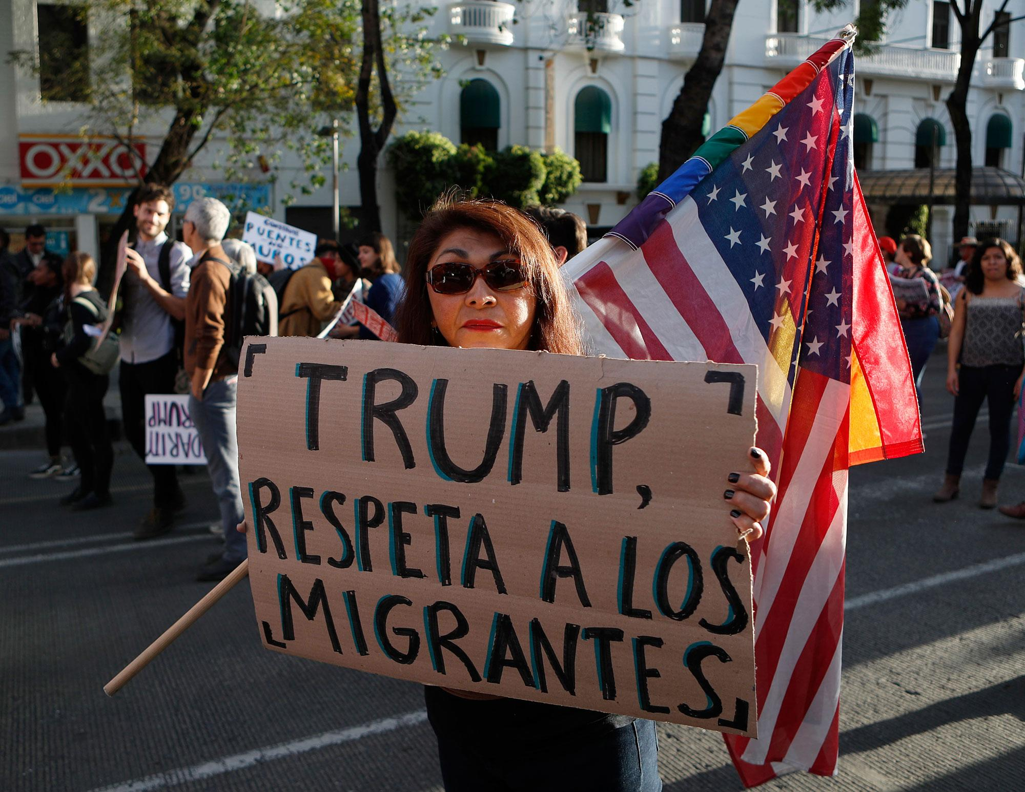 """<p>A woman holds a sign that reads in Spanish """"Trump, respect migrants"""" during a march called by a local women's movement against U.S. President Donald Trump in Mexico City, Friday, Jan. 20, 2017. Donald Trump became the 45th president of the United States Friday, Jan. 20 2017, amid apprehension in Mexico regarding his previous comments about Mexico and his promise to build a border wall to halt migration. (AP Photo/Eduardo Verdugo) </p>"""