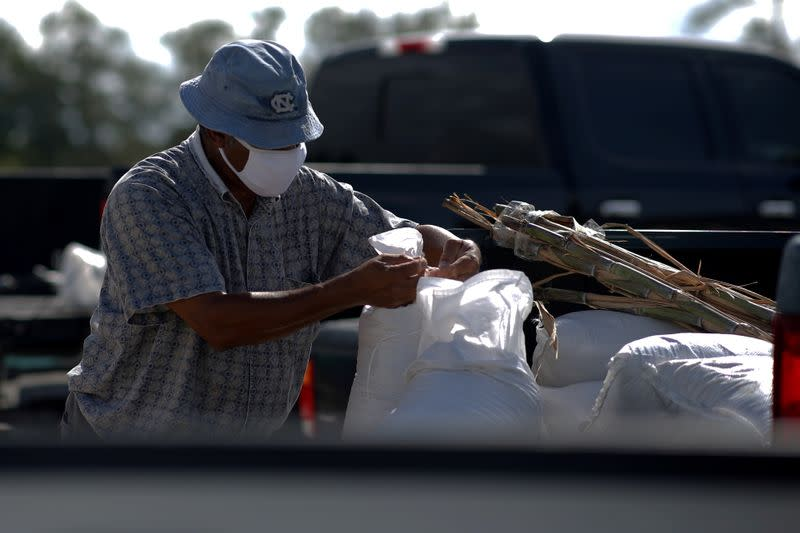 FILE PHOTO: Cornell Dorsey ties a sandbag in the back of his truck as Tropical Storm Sally approaches in Bay St. Louis