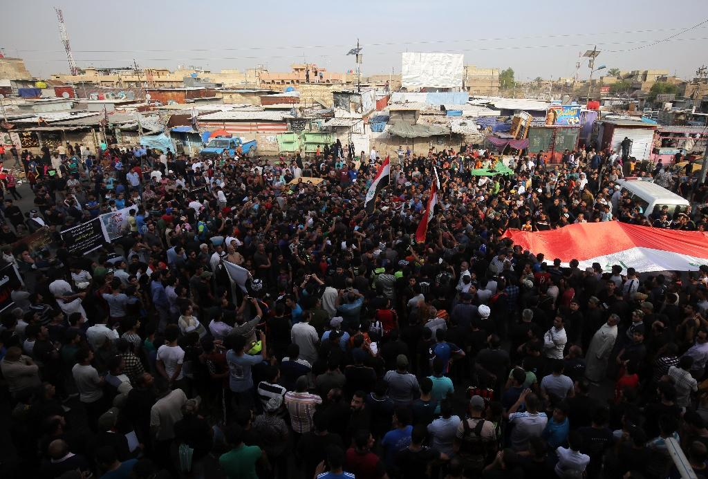 Supporters of Iraqi Shiite cleric Muqtada al-Sadr protest on May 12, 2016 in Baghdad's northern Shiite neighbourhood of Sadr City condemning the car bombing attack earlier in the week at a popular market in the area (AFP Photo/Ahmad Al-Rubaye)