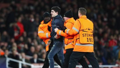 Arsenal fined by Uefa over Champions League pitch invader