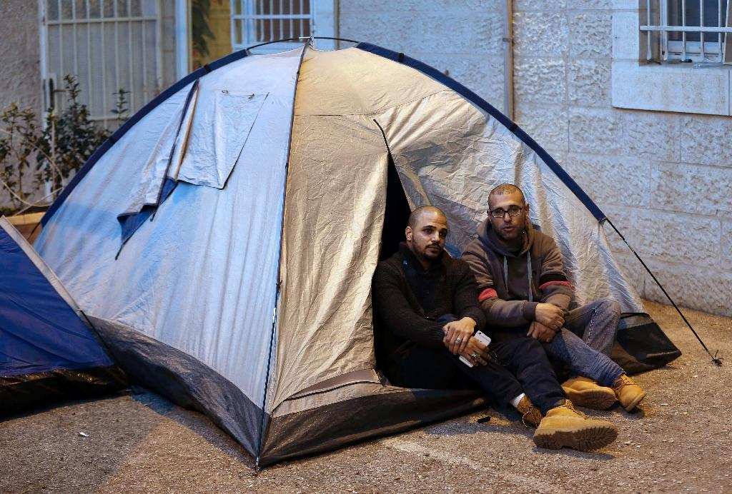 Samer Abu Eisheh (L) and Hijazi Abu Sbeih, Palestinians from Jerusalem, installed tents at the International Committee of the Red Cross (ICRC) in the city, defying a military order banning them from entering their hometown for months (AFP Photo/Ahmad Gharabli)
