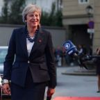 May, at summit, urges EU to 'evolve' Brexit position