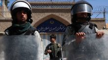 Afghans condemn Iran police after refugees die in car fire