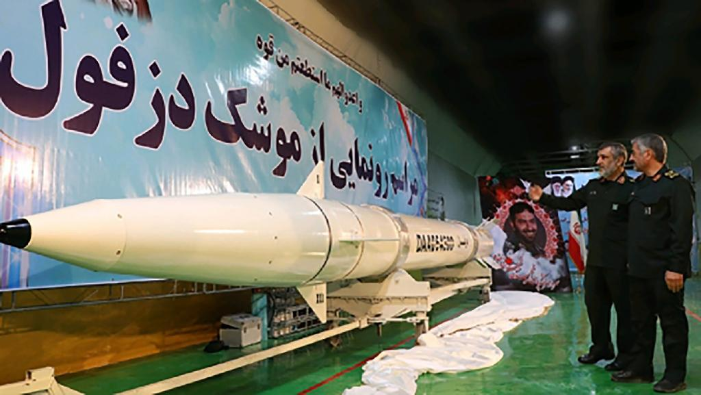 "Iranian Revolutionary Guards commander-in-chief Mohammad Ali Jafari (R) views the new ""Dezful"" missile, during an unveiling ceremony at an undisclosed location on February 7, 2019"