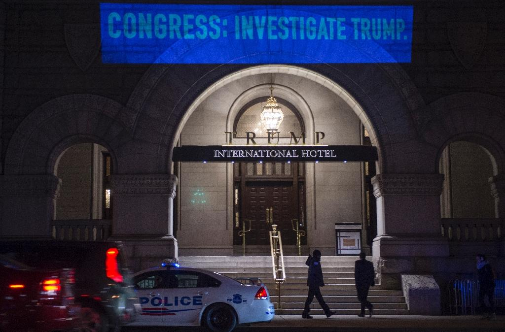 A Washington native, Bell has organized close to 20 nighttime operations against the Trump Hotel (AFP Photo/Andrew CABALLERO-REYNOLDS)