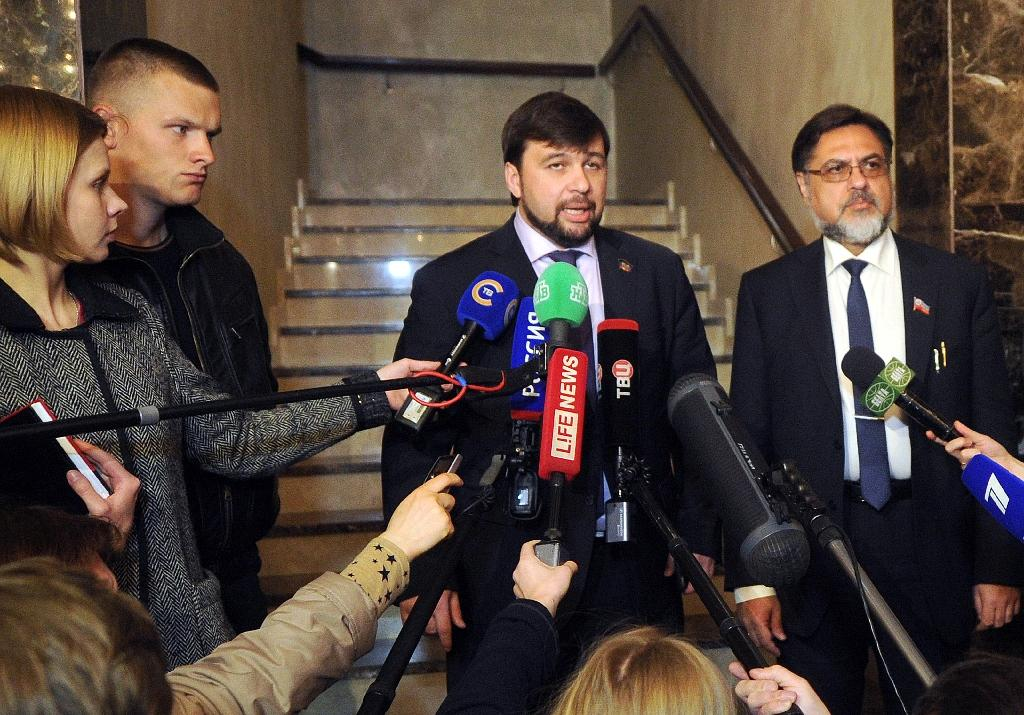 Representatives of self-proclaimed Donetsk and Luhansk People's Republics, Denis Pushilin (C) and Vladislav Deinego (R) talk to the press after a talk on resolving the Ukranian conflict on May 22, 2015 in Minsk