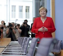 "The Latest: Merkel: Britain will ""find its way"" on Brexit"