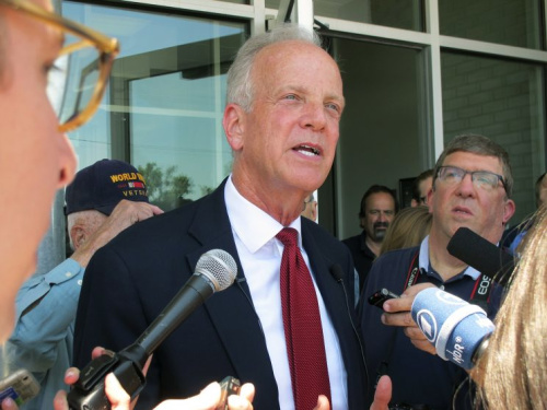 U.S. Sen. Jerry Moran, R-Kan., speaks to reporters following a town hall meeting, July 6, 2017, in the tiny town of Palco, Kan. Moran is facing tough questions about GOP efforts to overhaul health care.