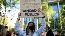 Virus curbs rile Europeans as global deaths near a million