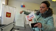 The Latest: Russian monitors report election irregularities