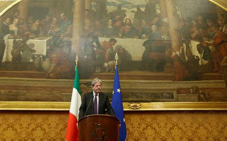 Italian Prime Minister-designate Paolo Gentiloni speaks to journalists at the end of a meeting in the Low Chamber in Rome, Italy December 12, 2016. REUTERS/Remo Casilli