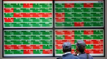 World stocks hold nerve after May's Brexit defeat, pound steady