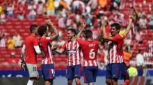 Atletico second as Carrasco, Griezmann strikes down Sevilla