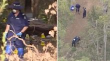 Police search for killer after woman's body found in shallow bush grave