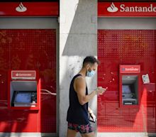 Santander Rebounds From Giant Loss With Profit, Capital Lift