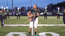 High school football player goes viral for his rendition of the national anthem