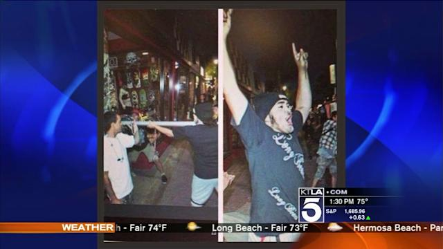 Rioter Who Smashed Bike Shop Window Sought by Police