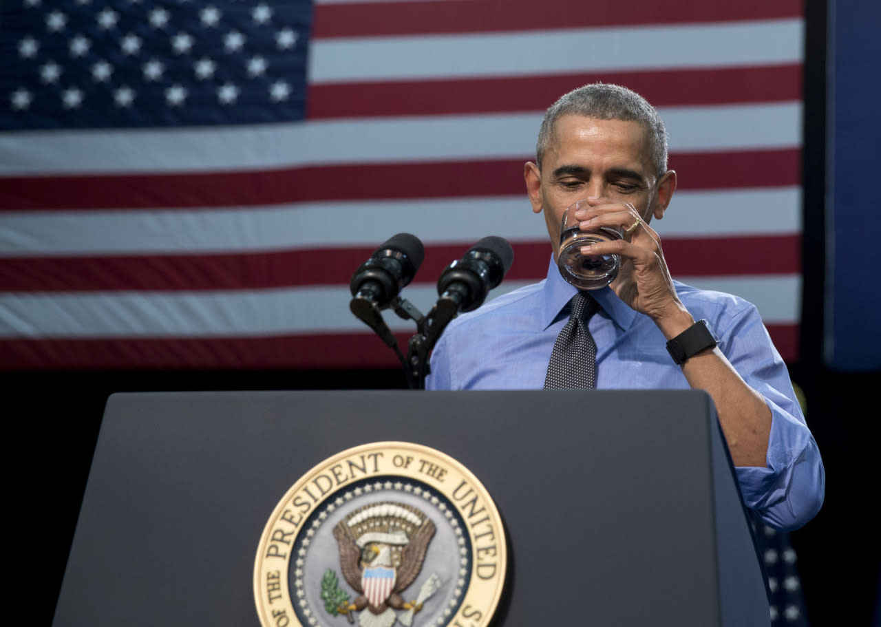 <p>Pres. Barack Obama takes a swig of water during his speech at Flint Northwestern High School in Flint, Mich., Wednesday, May 4, 2016. <i>(Photo: Carolyn Kaster/AP)</i></p>