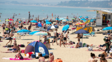 Britain basks in the heat as temperatures peak at 34C in the hottest June since 1976