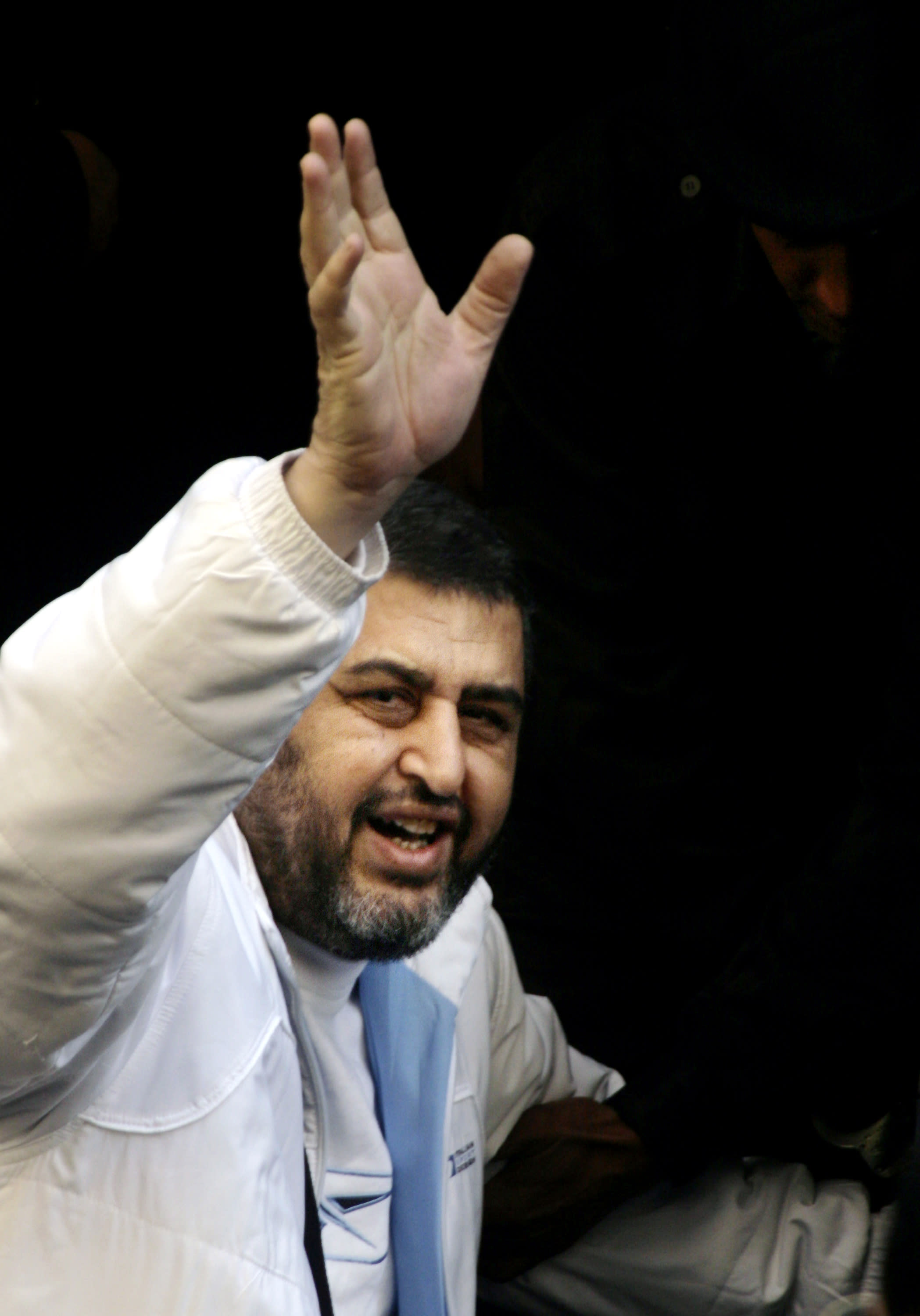 FILE- In this Monday, Dec. 10, 2007 file photo, Egyptian Muslim Brotherhood's top financial figure Khayrat el-Shater gestures as he leaves a prison vehicle to enter one of his civilian investigations in Cairo, Egypt. Egypt's Muslim Brotherhood on Saturday said it decided to field the movement's deputy leader and top strategist as its presidential candidate, topping off its success in legislative elections with a bid for the country's most powerful post. Top leaders of the country's most influential political group announced in a press conference that it selected Khayrat el-Shater to contest the presidential race set to start in May.(AP Photo/Amr Nabil, File)