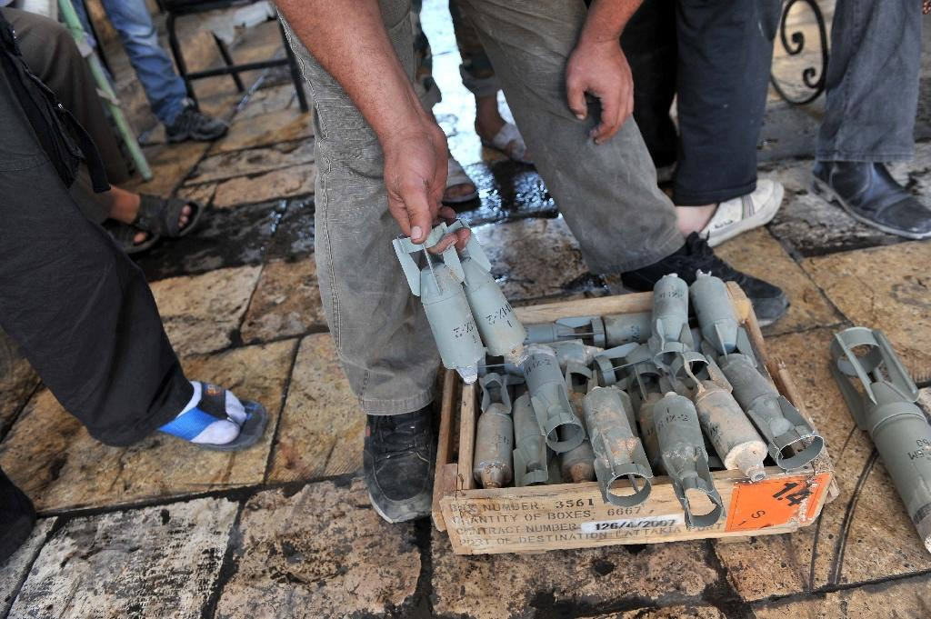 A Syrian rebel shows what appears to be cluster bomblets which they accuse pro-regime forces of using during a 2012 attack on the northwestern town of Maaret al-Numan (AFP Photo/Bulent Kilic)