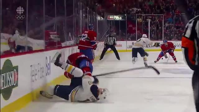 Ryan White delivers a heavy hit on Ehrhoff