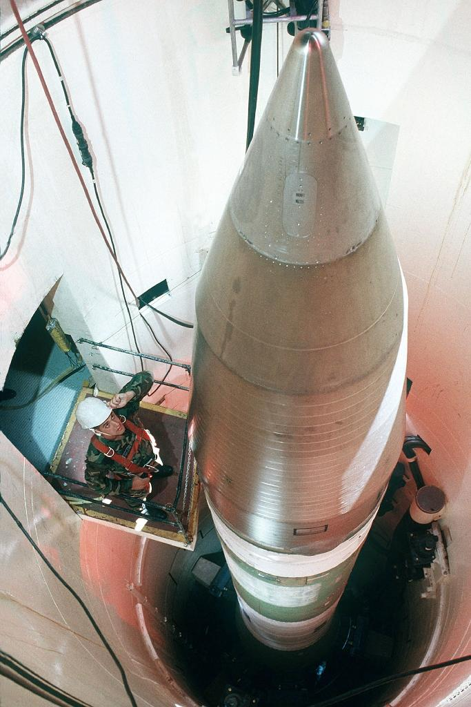 An Air Force technician inspecting an LGM-30G Minuteman III nuclear missile inside a silo about 60 miles from Grand Forks Air Force Base, in North Dakota (AFP Photo/HO)