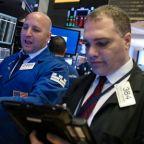 Apple, trade woes sink stocks; growth worries drag on dollar