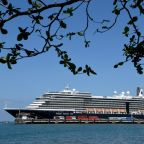 Cruise operator races to track Cambodia passengers over virus fears