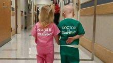 'Cute' hospital photo of two kids wearing scrubs branded 'sexist'