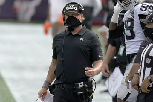 Las Vegas Raiders head coach Jon Gruden works along the sideline in the second half of an NFL football game against the New England Patriots, Sunday, Sept. 27, 2020, in Foxborough, Mass. (AP Photo/Steven Senne)