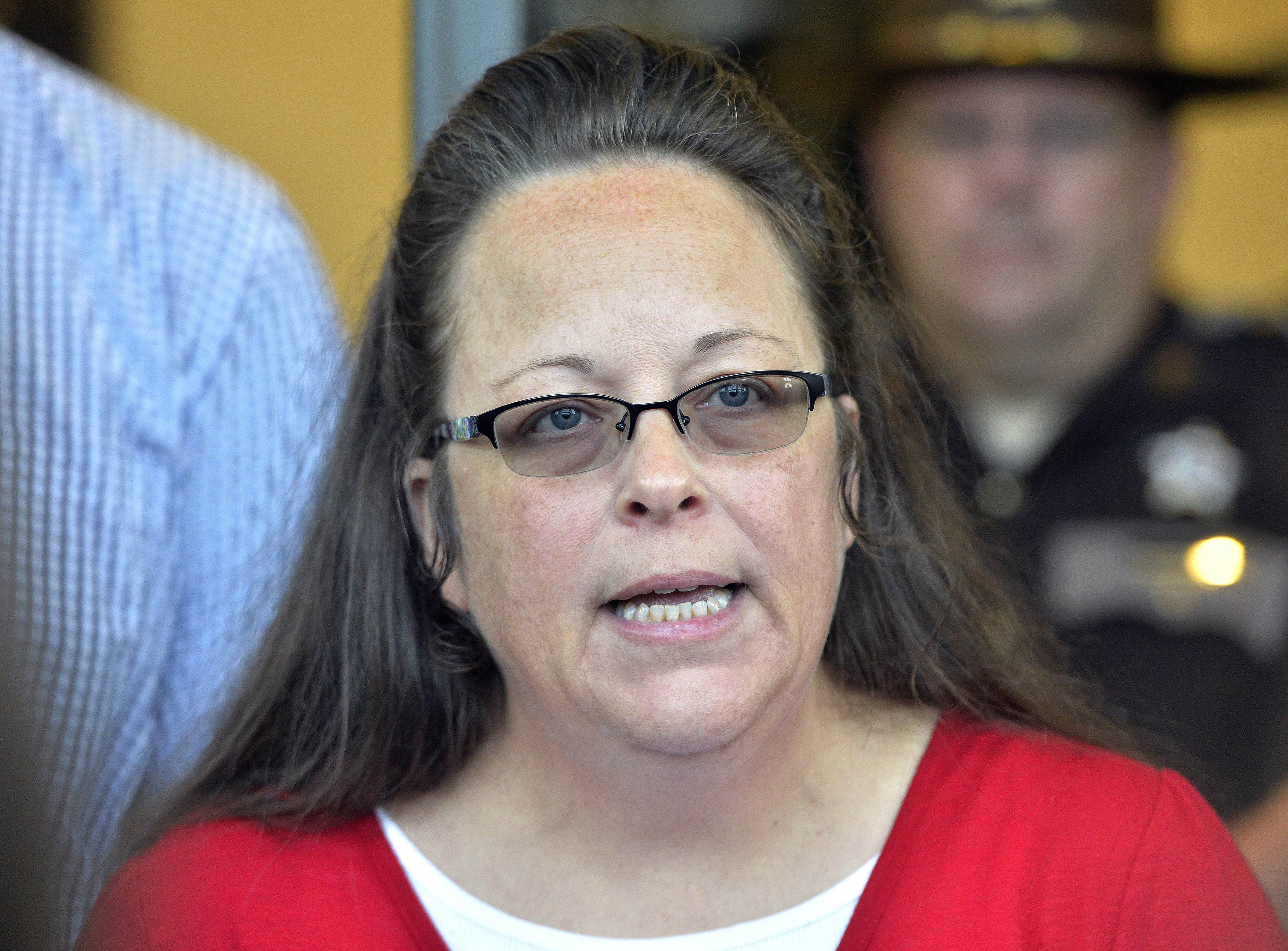 FILE - In this Sept. 14, 2015, file photo, Rowan County Clerk Kim Davis makes a statement to the media at the front door of the Rowan County Judicial Center in Morehead, Ky. Outside attorneys for Republican Kentucky Gov. Matt Bevin say the former county clerk who stopped issuing marriage licenses because of her opposition to gay marriage broke the law and the state shouldn't have to pay legal fees for people who sued her. A federal appeals court is scheduled to hear arguments Thursday, Jan. 31, 2019, about who should pay the lawyers for several gay and straight couples who sued Davis in 2015. (AP Photo/Timothy D. Easley, File)