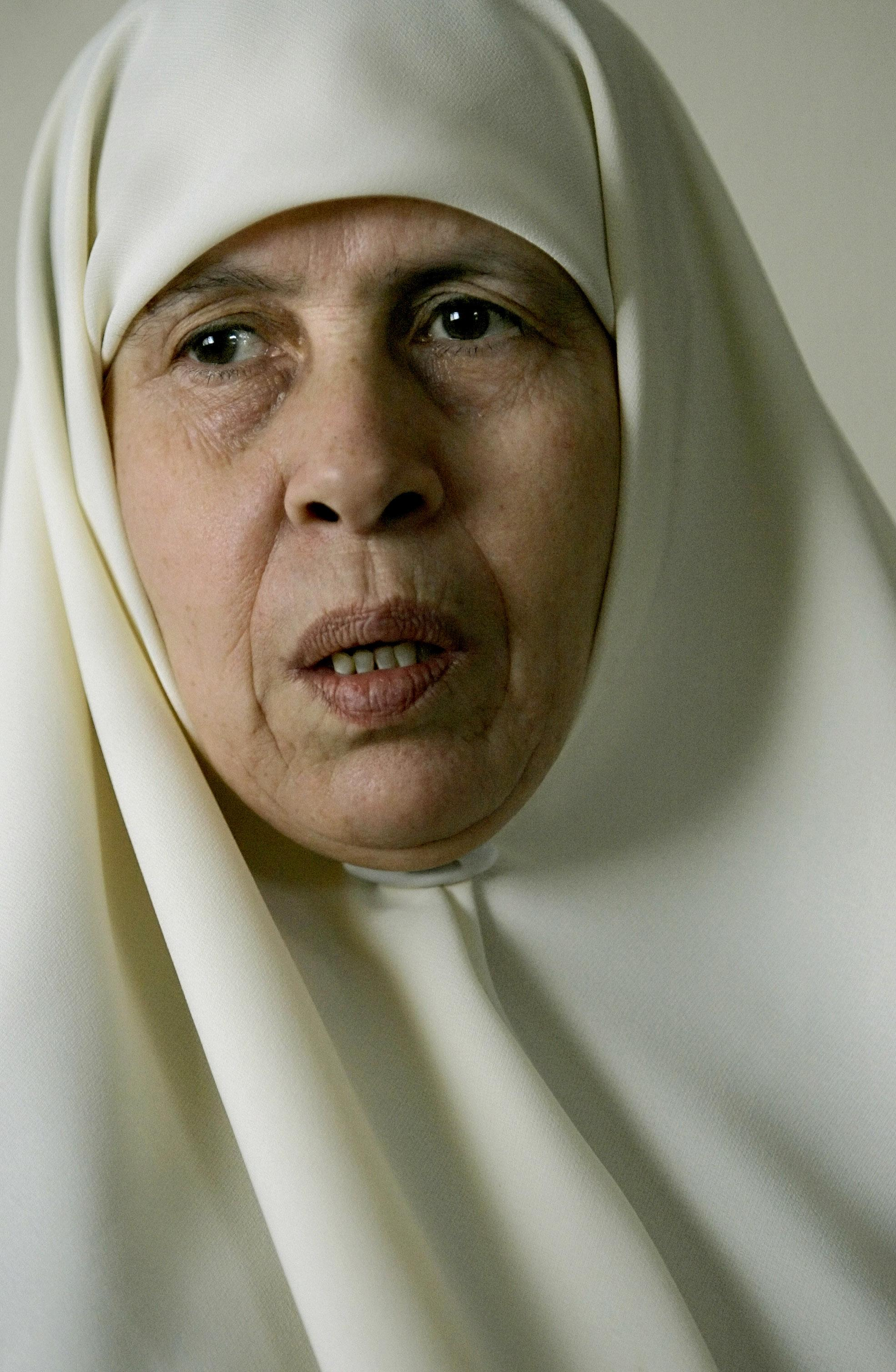 """FILE -- In this Thursday, Feb. 16, 2006 file photo, Mariam Farhat is seen in her house in Gaza City. Farhat, 64, died in Gaza City, Sunday, March 17, 2013. Farhat, who known as the """"mother of martyrs,"""" lost three of her six sons, all three Hamas militants, in fighting with Israel. (AP Photo/Alexander Zemlianichenko, File)"""