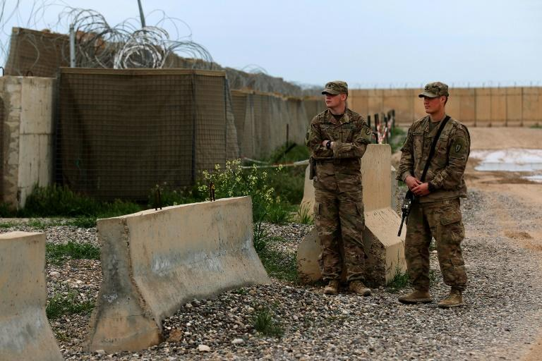 US soldiers stand at the Qayyarah Air Base, where US-led troops in 2017 helped Iraqis plan out the fight against the Islamic State in nearby Mosul