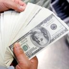 Dollar eases off of two-week high ahead of jobs report