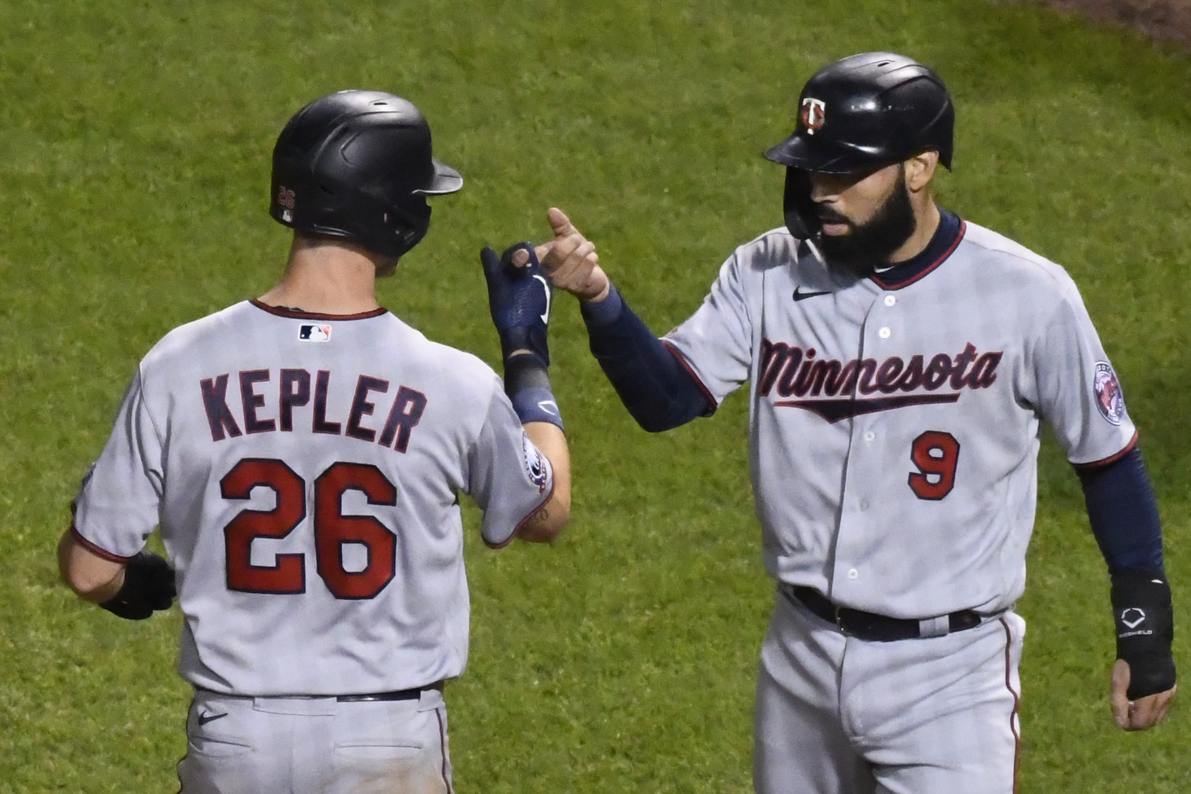 Minnesota Twins' Max Kepler (26) celebrates with Minnesota Twins' Marwin Gonzalez (9) after they scored on Kepler's two-run home run during the seventh inning of a baseball game against the Chicago Cubs Sunday, Sept. 20, 2020, in Chicago. (AP Photo/Matt Marton)