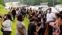 Long lines at George Floyd memorial as further protests expected across US