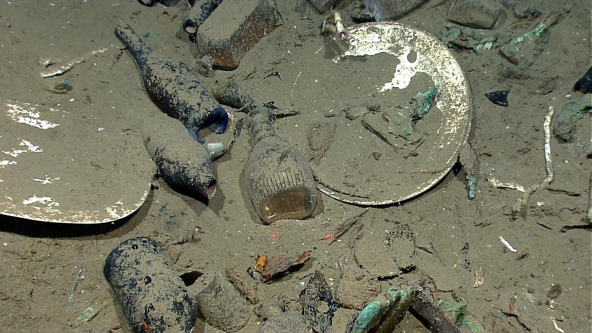 This photo provided by the NOAA Okeanos Explorer Program shows a variety of artifacts including ceramic plates, platters, bowls plus glass liquor, wine, medicine, and food storage bottles of many shapes and colors found inside a wrecked ship's hull, in the Gulf of Mexico about 170 from Galveston, Texas. It may have sunk in the Gulf of Mexico 200 years ago. (AP Photo/NOAA Okeanos Explorer Program)