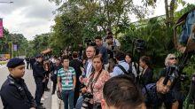 Trump-Kim summit: Journalist escorted away by police on Sentosa amid media fracas