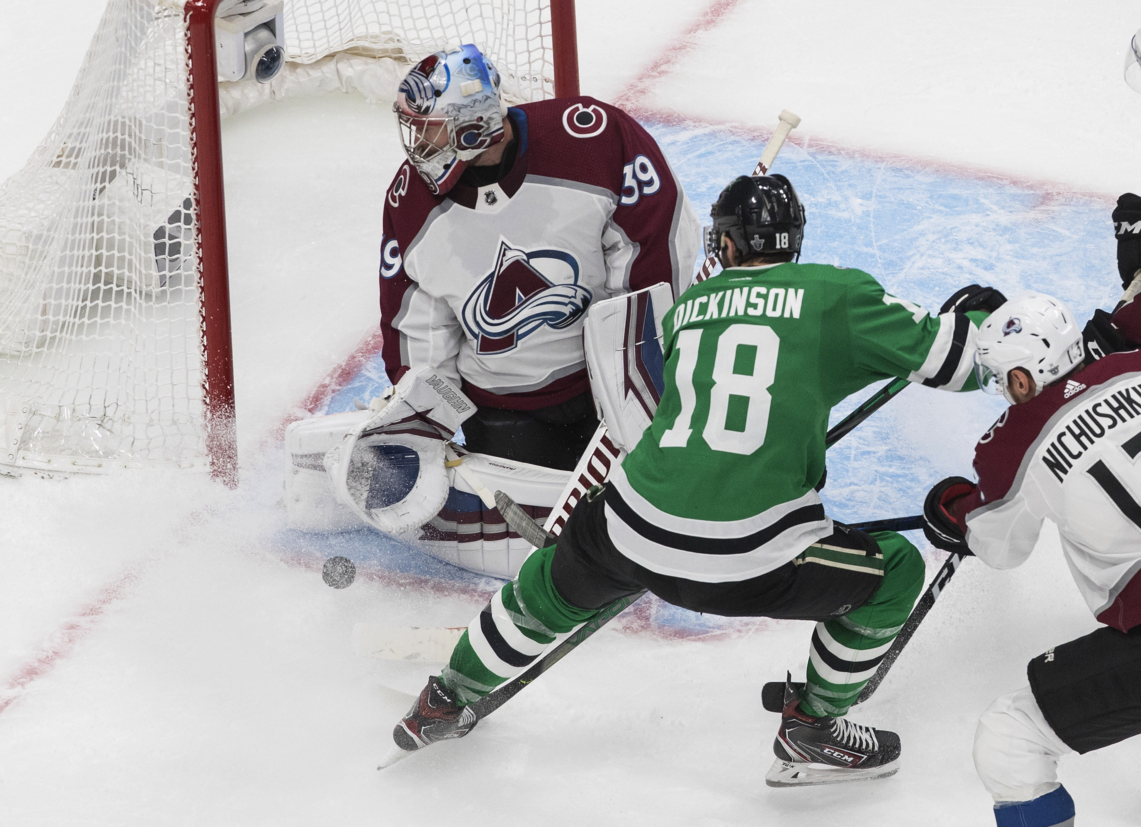 Dallas Stars' Jason Dickinson (18) is stopped by Colorado Avalanche goalie Pavel Francouz (39) during the third period of Game 3 of an NHL hockey second-round playoff series, Wednesday, Aug. 26, 2020, in Edmonton, Alberta. (Jason Franson/The Canadian Press via AP)
